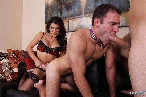 Stunning Dominatrix Grips A Guys Ball Bisex Domination Smothering