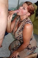 Sexy redhead swallowing cum