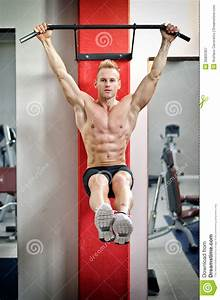 Young Man Hanging From Gym Equipment Stock Image