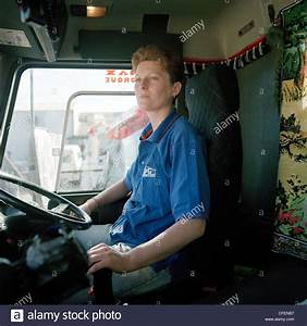 Female Lorry Driver In The Cab Of Her Volvo Tipper Truck
