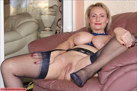 Shaved Granny Takes A Wet Rod Up Her Twat