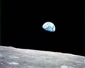 Earth Rising Above the Surface of the Moon Desktop Wallpaper