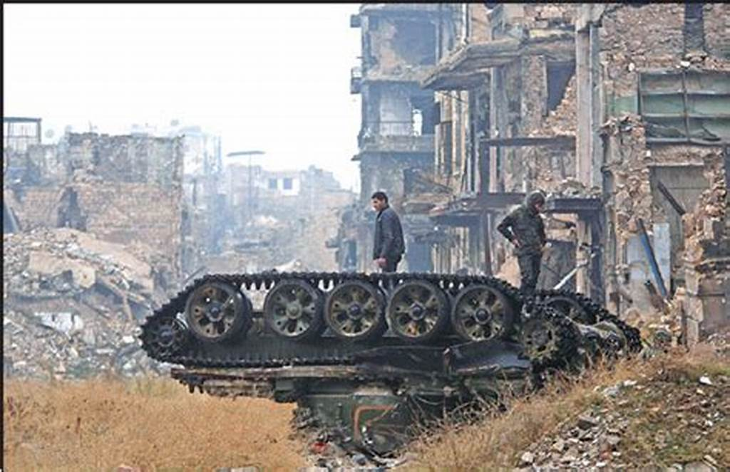 #Forces #Loyal #To #The #Syrian #Government #Stand #Atop #A #Damaged
