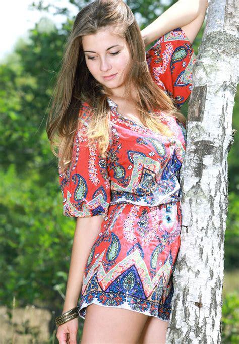 Marta E - Marta E playing outdoor in a vibrant paisley romper
