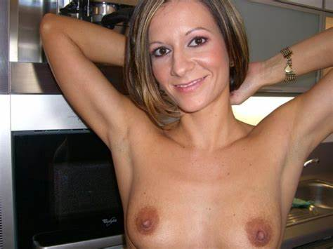 Comely Woman Flashing In Restroom