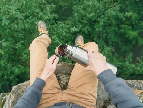 Pov is a stylish cafe serving a variety of fresh specialty coffees, cold brews, teas, grab and go located right in front of the stella, p.o.v. POV Of Traveler Pouring Tea From Thermos Stock Photo ...
