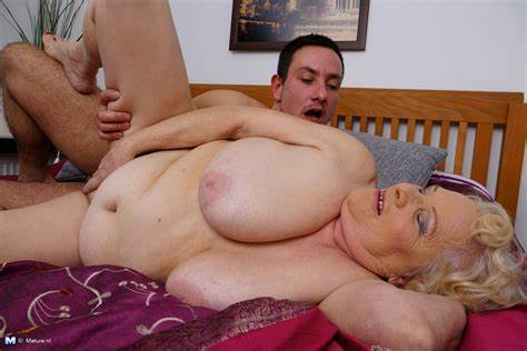 Caucasian Granny Playing With A Porn Toy