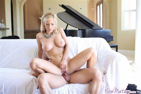 Dolled Up Pornstar Rides A Fellows Cock