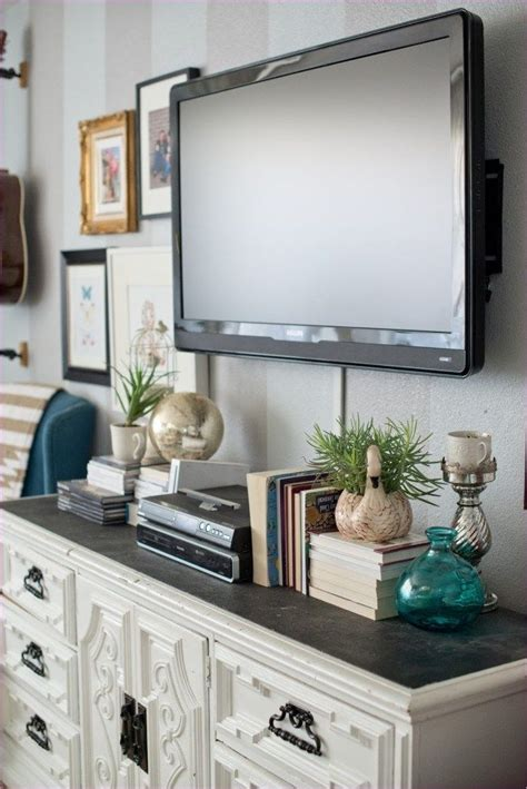 Depending on whether your television is mounted on a wall, located inside a functional entertainment center with or without doors, or you have it on a mantle, you have plenty of options. 50 Stunning Gallery Wall Above Dresser Ideas   Home living room, Decor around tv, Living room decor