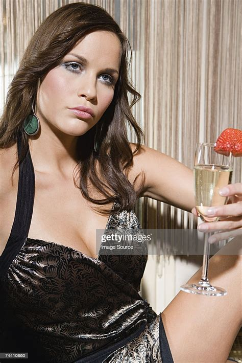 Glamorous Young Woman High-Res Stock Photo - Getty Images