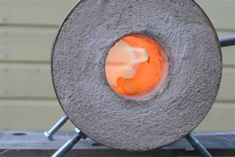 Testing out my coffee can forge with new propane burner heating a rail road spike.there is still some tweaking to be done but. DYI Coffee Can Forge - Andrew W