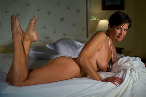 Brunette Granny In Topless Posing And Teasing