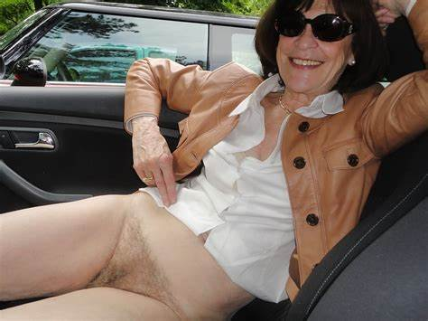 This Mature Nudist Model Flashes Her Fine Cunt