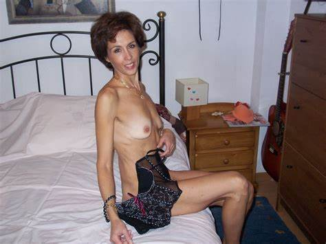 Mature Brunette Changing In The Home