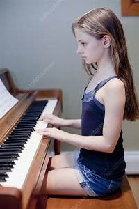 Girl Practicing Piano Indoors - Stock Image  5113