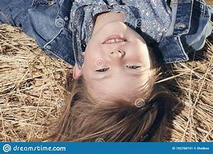 Portrait, Of, A, Little, Girl, Upside, Down, On, A, Haystack, Stock